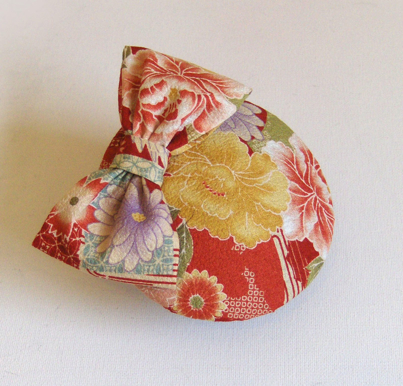 http://folksy.com/items/4415516-Cocktail-hat-kimono-silk-red-with-bow-
