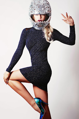 Model builds her agency portfolio with a futuristic glam style shoot with glitter biker helmet and fishtail braid