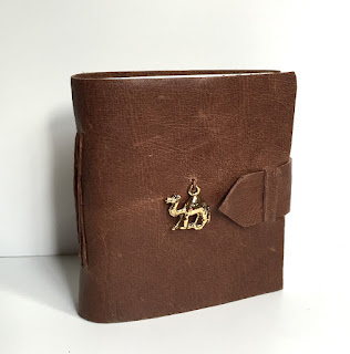 https://www.etsy.com/listing/245408352/brown-leather-mini-journal-with-camel?ref=listing-shop-header-3