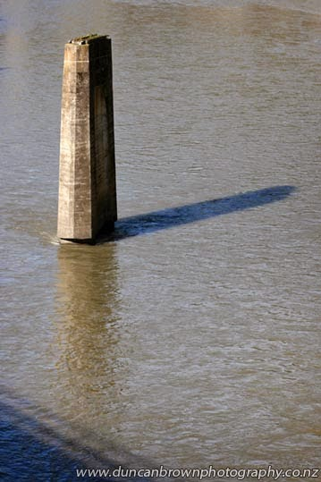 The time is 12-17pm, the old Mohaka road bridge still casts its shadow photograph