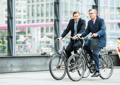 Businessmen riding bikes to work