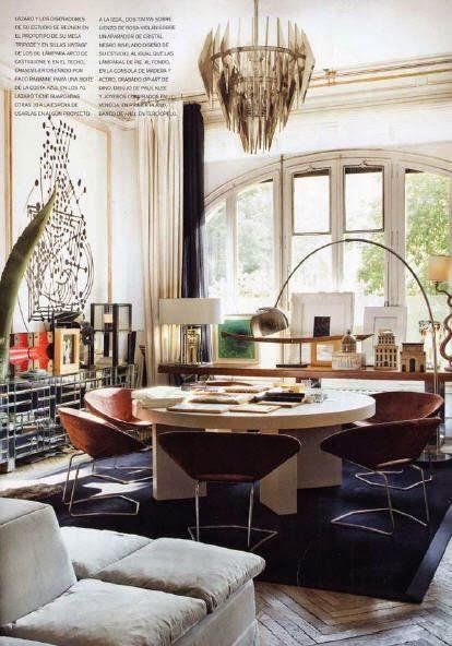 artsy open multi use living room large windows modern lighting