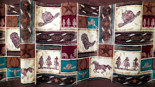 close up of the cowboy fabric for the shower curtain runner