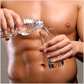 Man with abs pouring water