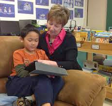 Kathy Cassidy helping a student with an assignment