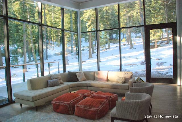 modern glass box in the woods yet still homey inside