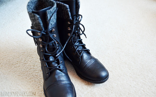 Close-up on the knit-trim lace-up mid-calf faux leather combat boots from AMIClubwear.