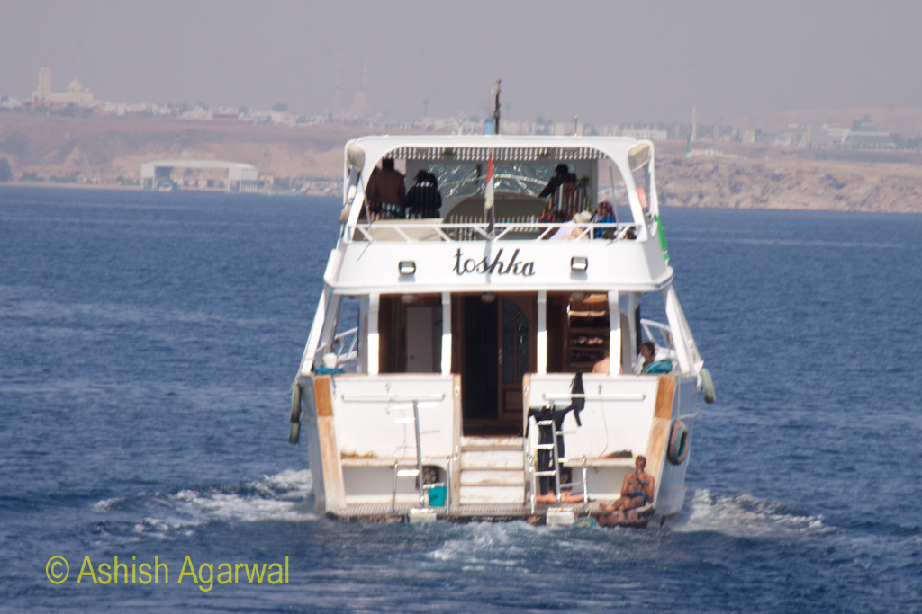 Rear view of a small ship taking tourists from Sharm el Sheikh to the Ras Muhammed marine park in Egypt
