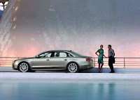 Guy and girl with Audi A8 L