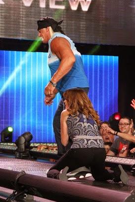 begging Dixie Carter holding Hulk Hogan's leg