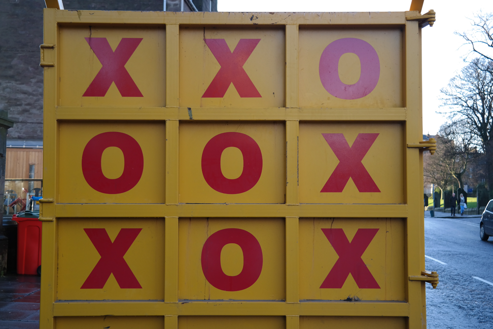 Noughts and crosses on a skip