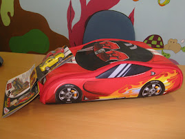 Mochila Carro que se transforma em tapete (inclui 2 carros)