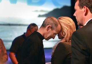 Steve Jobs face hugging With Laurene Powell