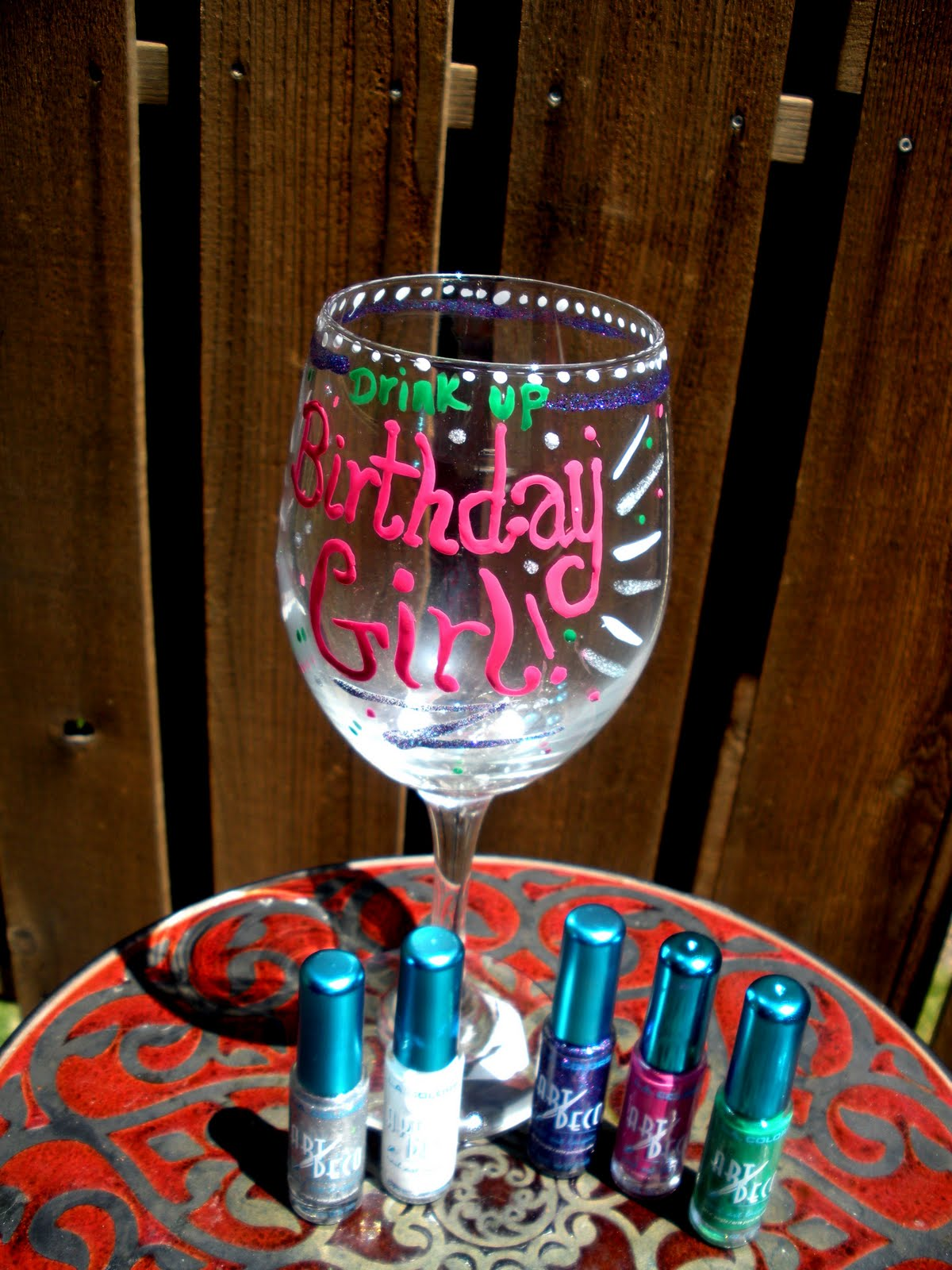 Decorate a wine glass using nail polish!