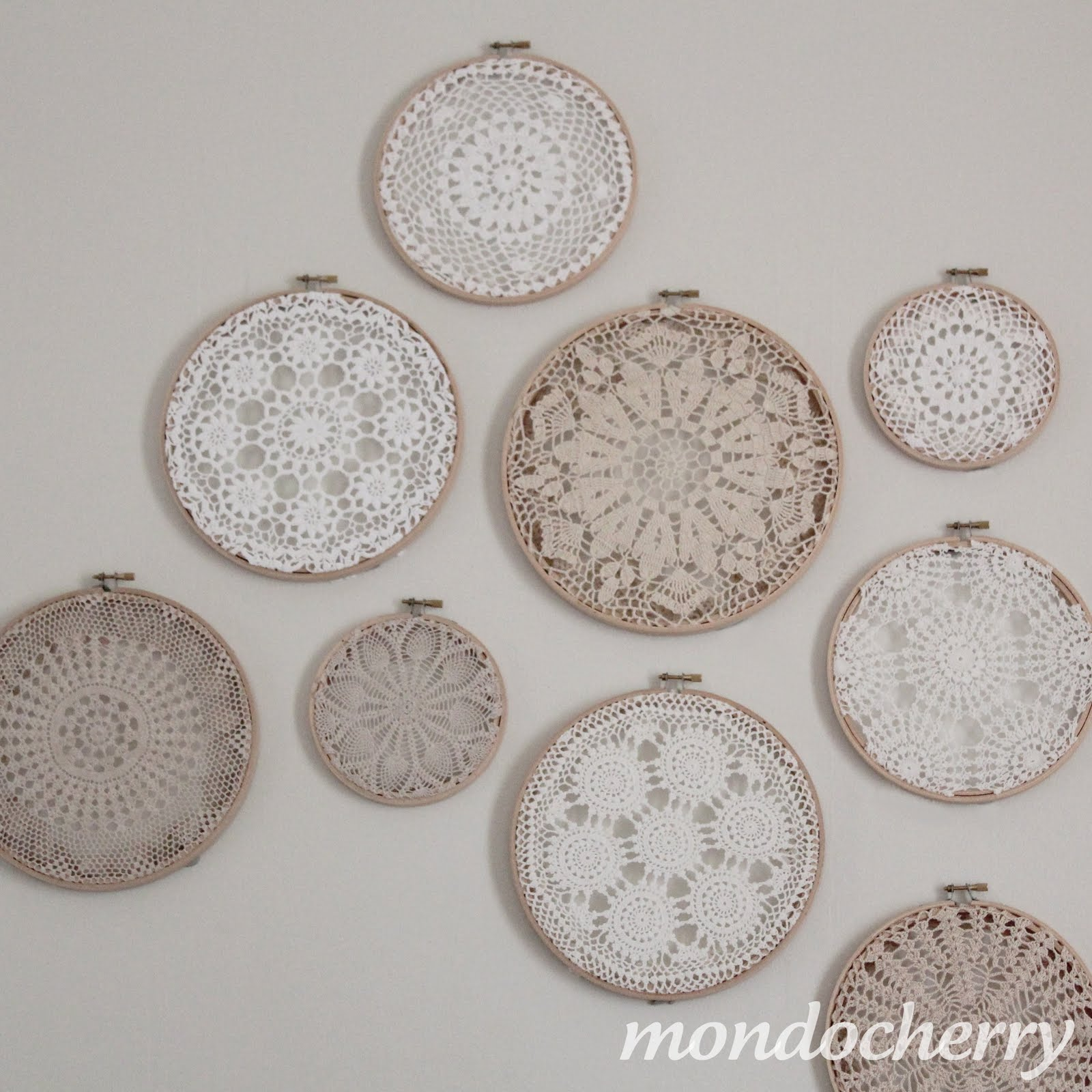 A small bite of mondocherry: embroidery hoops + doilies = art...