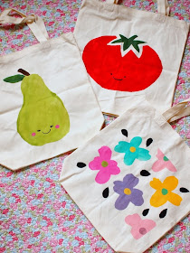 freezer paper stenciled pear, tomato, and flower design bags