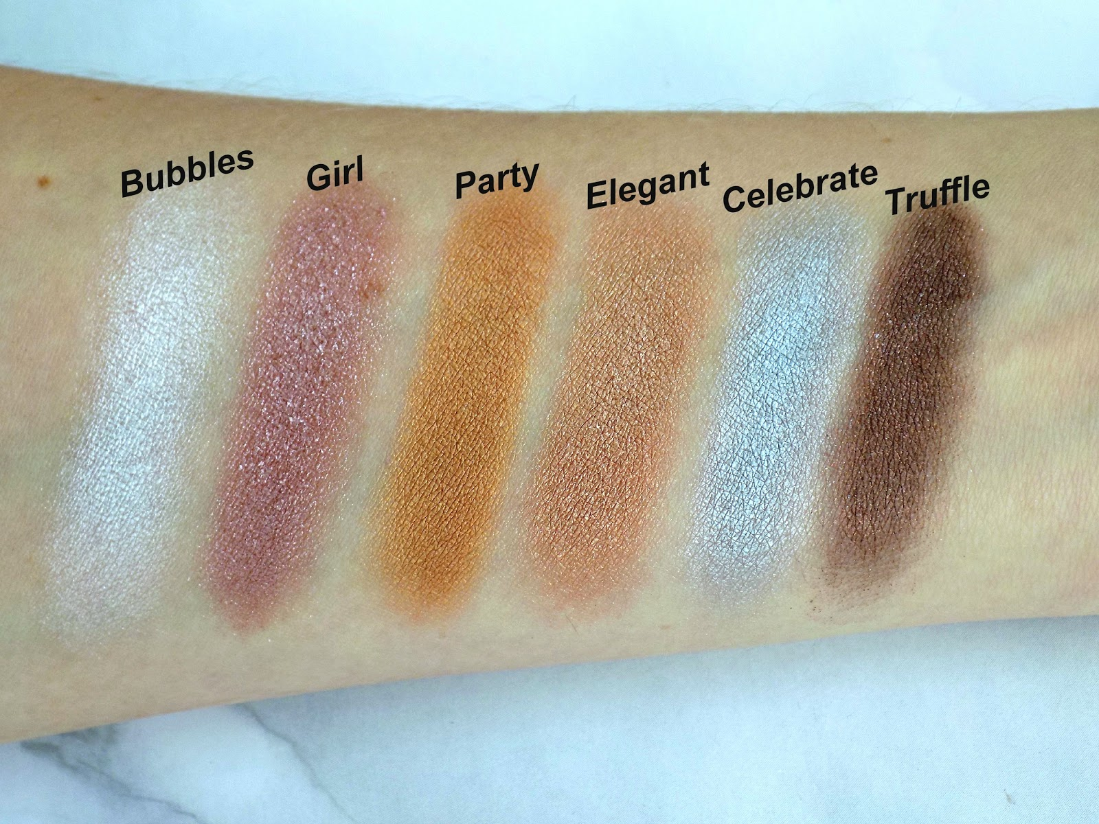 Makeup Revolution 'Pink Fizz' palette swatches