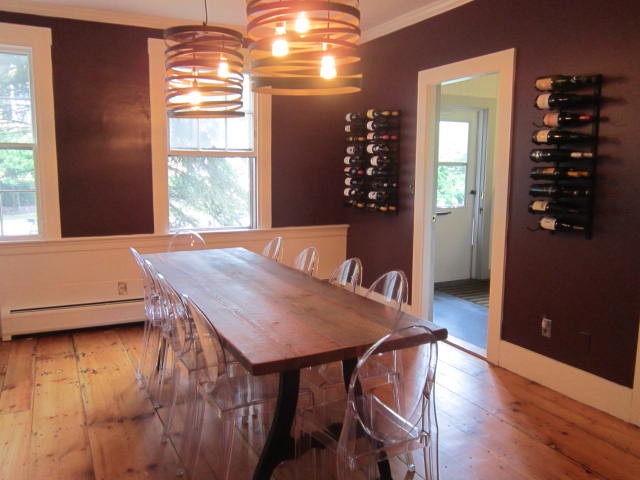 wine tasting room furniture. check out the old wood table contrasting with clear ghost chairs in their wine tasting room furniture