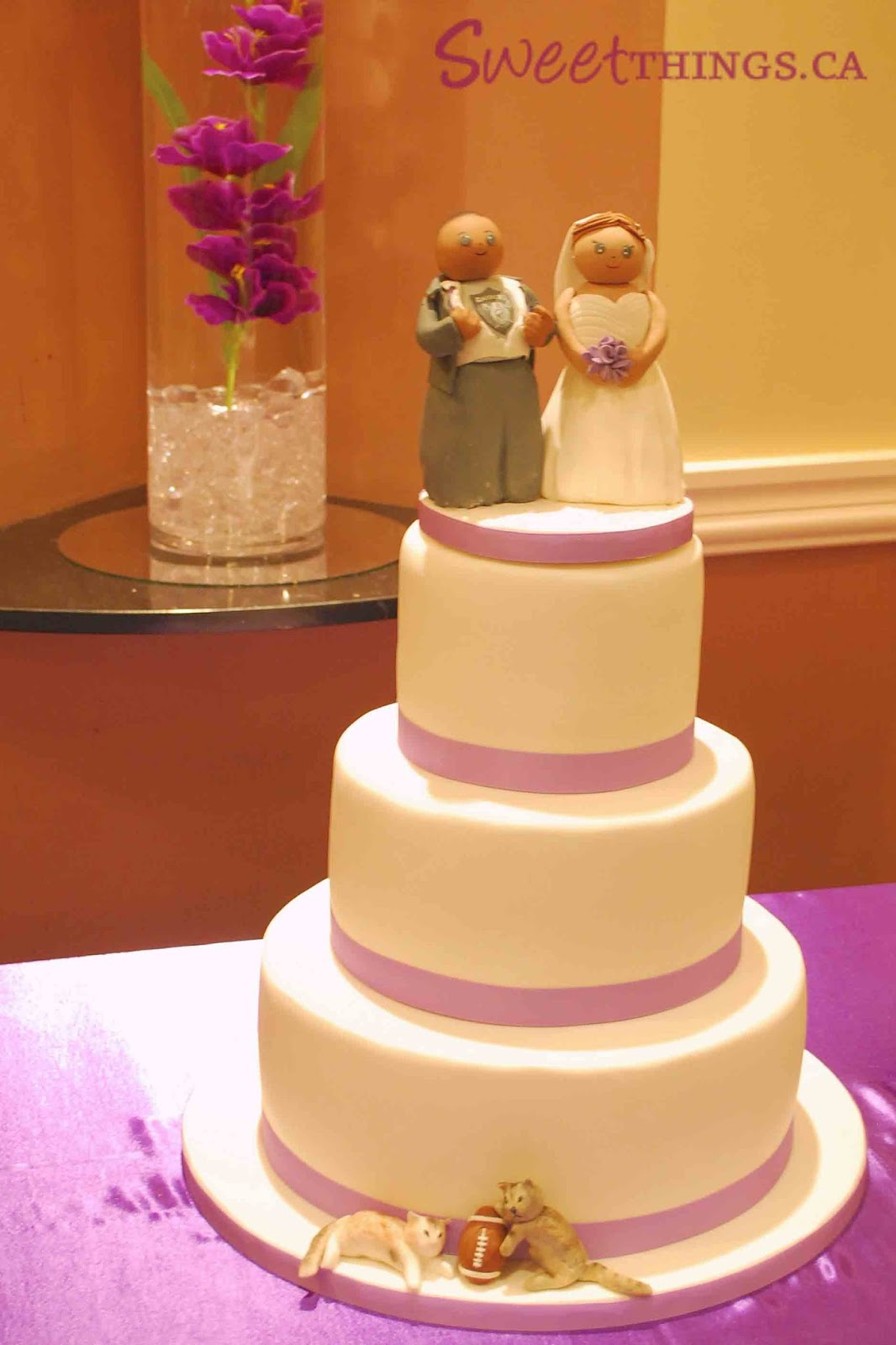 SweetThings Wedding Cake with a Hint of Purple and Football