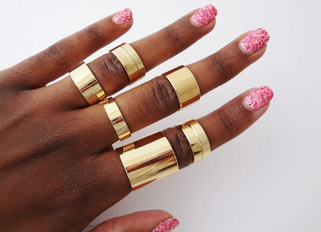 ASOS Pack of 8 Smooth Rings on dark skin black girl fingers.