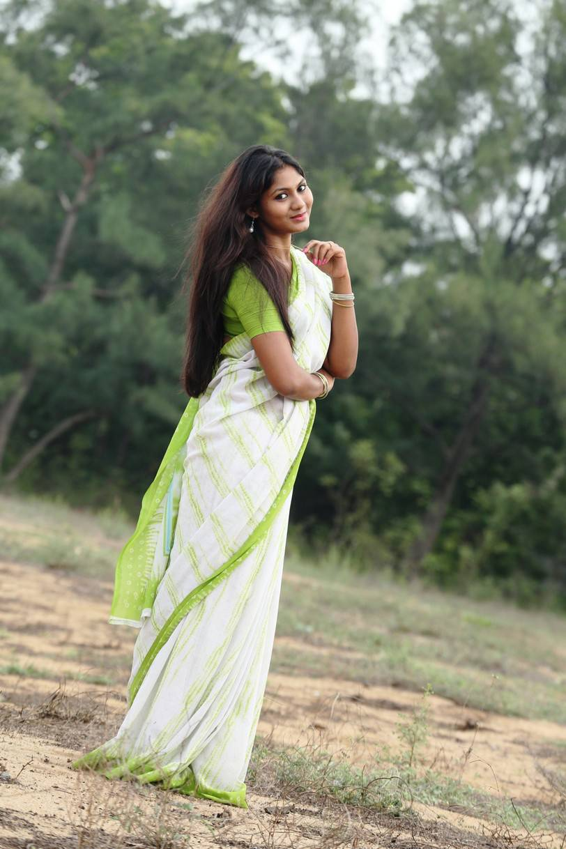 Shruthi Reddy Latest Photoshoot Stills In Parrot Green Saree