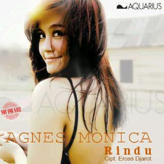 model rambut agnes monica di video klip rindu
