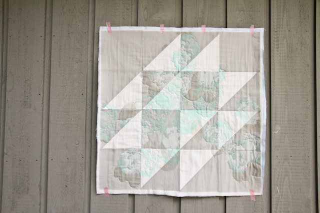 partially quilted hovering birds wall quilt overprinted with hydrangeas