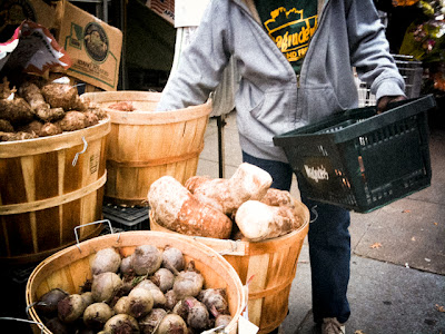 Woman shopping for produce at Magruder's Market, NW Washington DC.