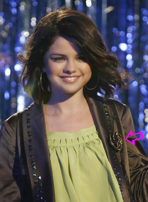 Selena Gomez wearing a flower zipper brooch by Jenny Dayco