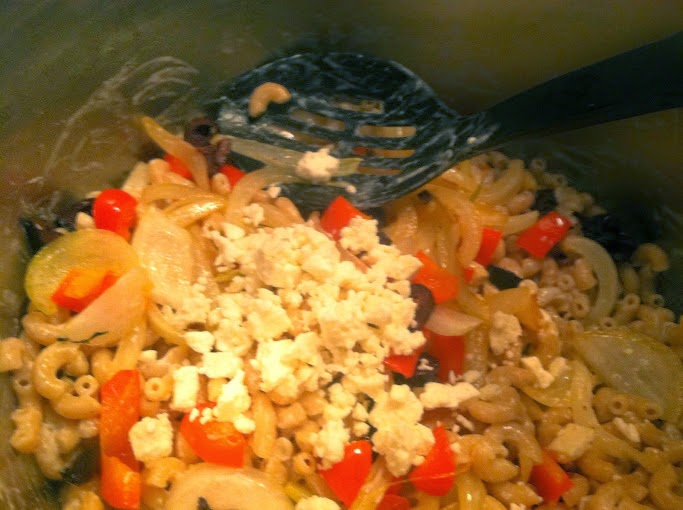adding feta for a tasty mac & cheese casserole topped with beef and stewed tomatoes. Cooking Chat recipe.