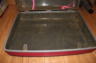 Recycled crafts:  cleaning the repurposed suitcase