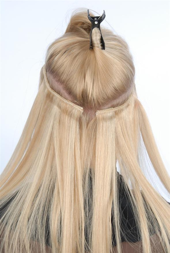 is a photo of how clipin extensions are pinned into a section of hair