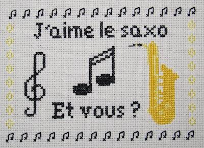 """Cuadro punto de cruz """"J'aime le saxo, et vous?"""""""