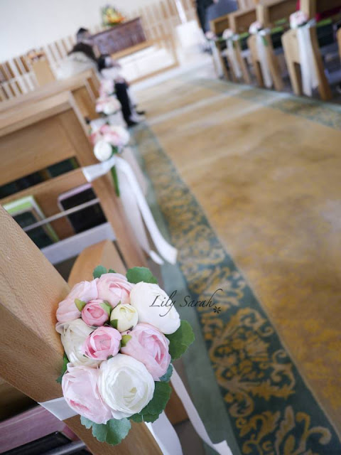 church wedding pew end floral decoration by Lily Sarah