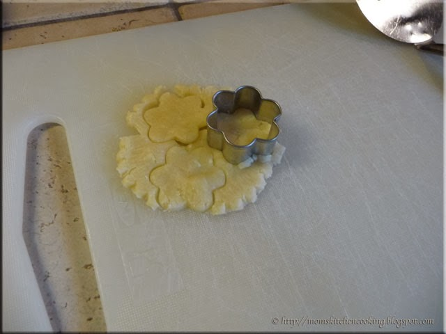 cutting out the decorative pastry topping