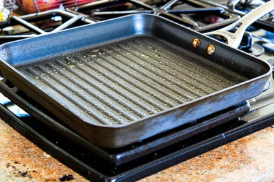 heating pan for Easy Recipe for Greek Salmon Cooked in a Grill Pan found on KalynsKitchen.com