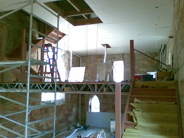 Looking from the lower stairs note the cross in the void that will be glazed to walk on!!!