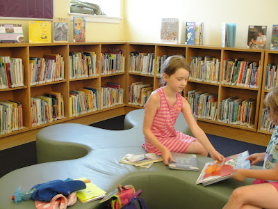 kids reading books at library