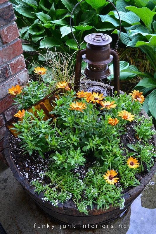 garden junk DIY salvaged rust garden art outdoors gardening decorating funky junk interiors shed yard clean up geraniums barrel