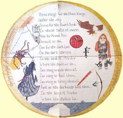 Circular artwork with the Ring as a frame and the Ring poem in the center, surrounded by spot illustrations of a dwarf, eagle, orc and other Tolkien inventions