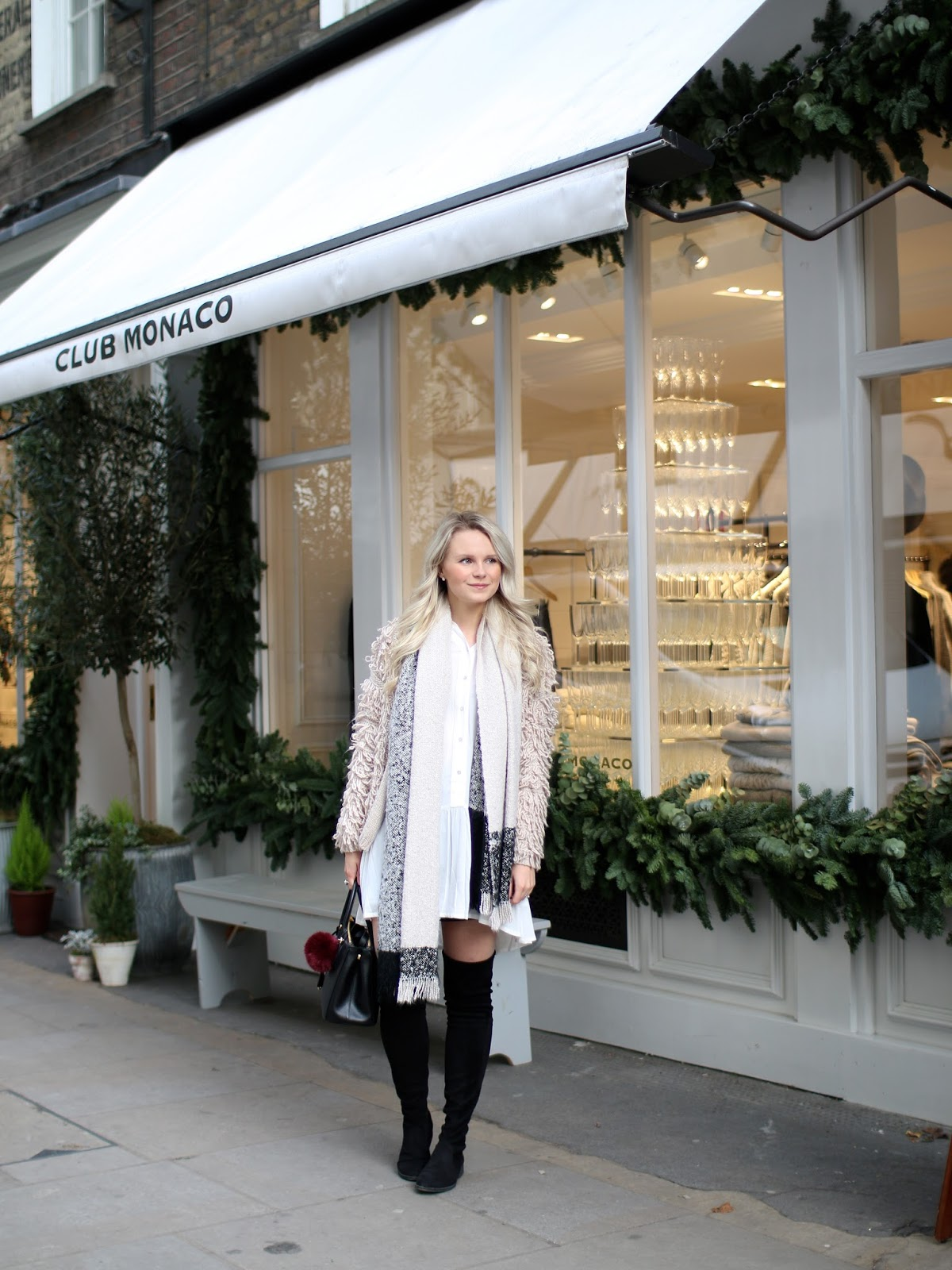 exploring seven dials in london, while shopping in my black over the knee boots from Office