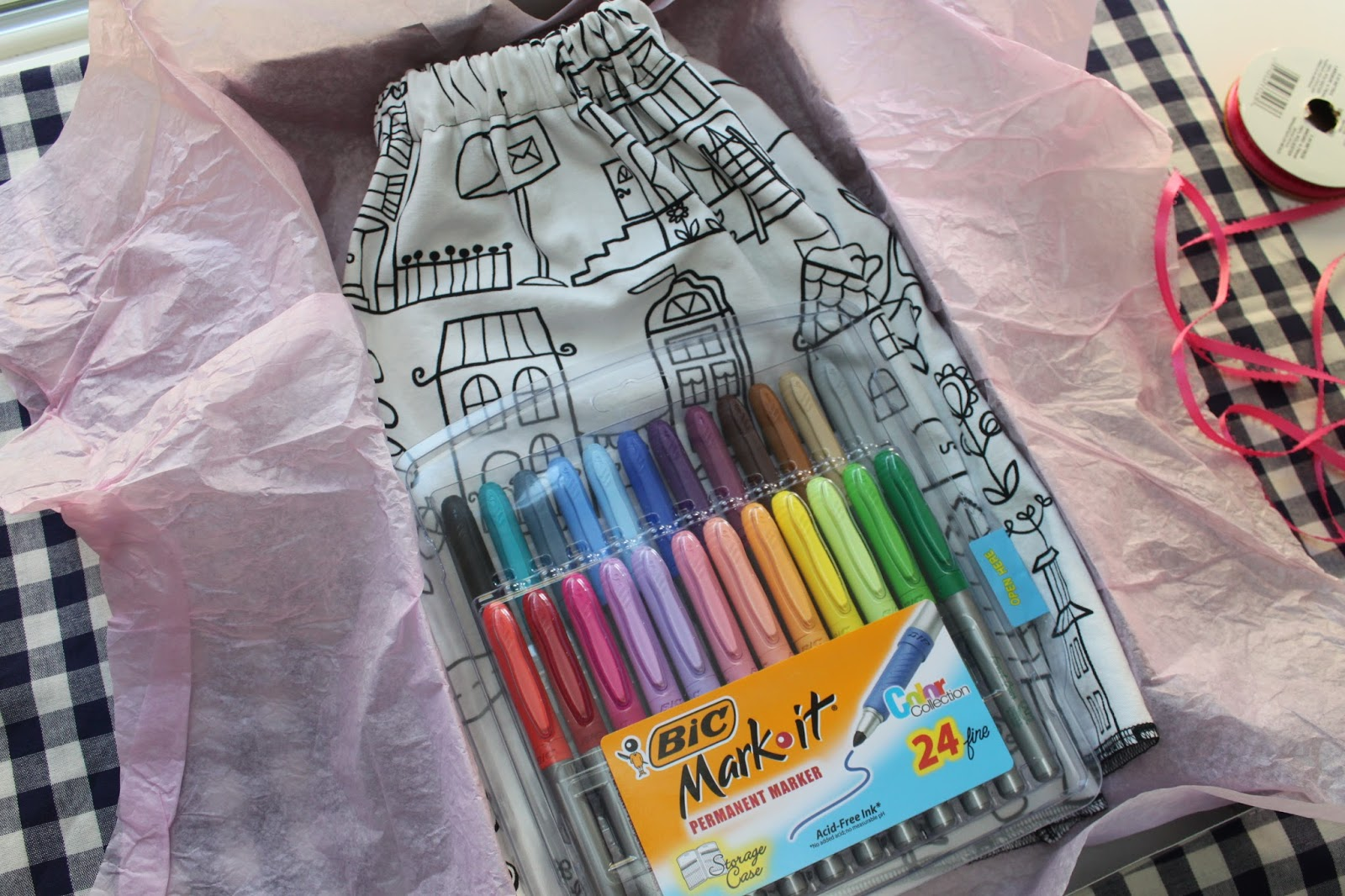 use fabric markers or paint pens and packaged it up for my little niece for christmas i know shes going to have a ton of fun coloring her skirt
