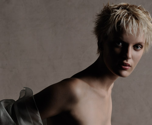 Sydney fashion photographer shoots modelling portfolio of model with short blonde hair, studio fashion portrait by Gilbert Rossi
