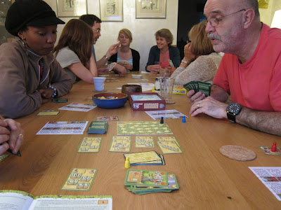 Nottingham - Two of the players consider their options, with the players of Bohnanza in the background