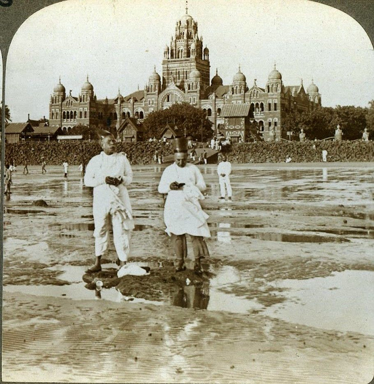 Parsi Men Worshiping New Moon. Central India Railway Building in the Background - Bombay (Mumbai) 1903