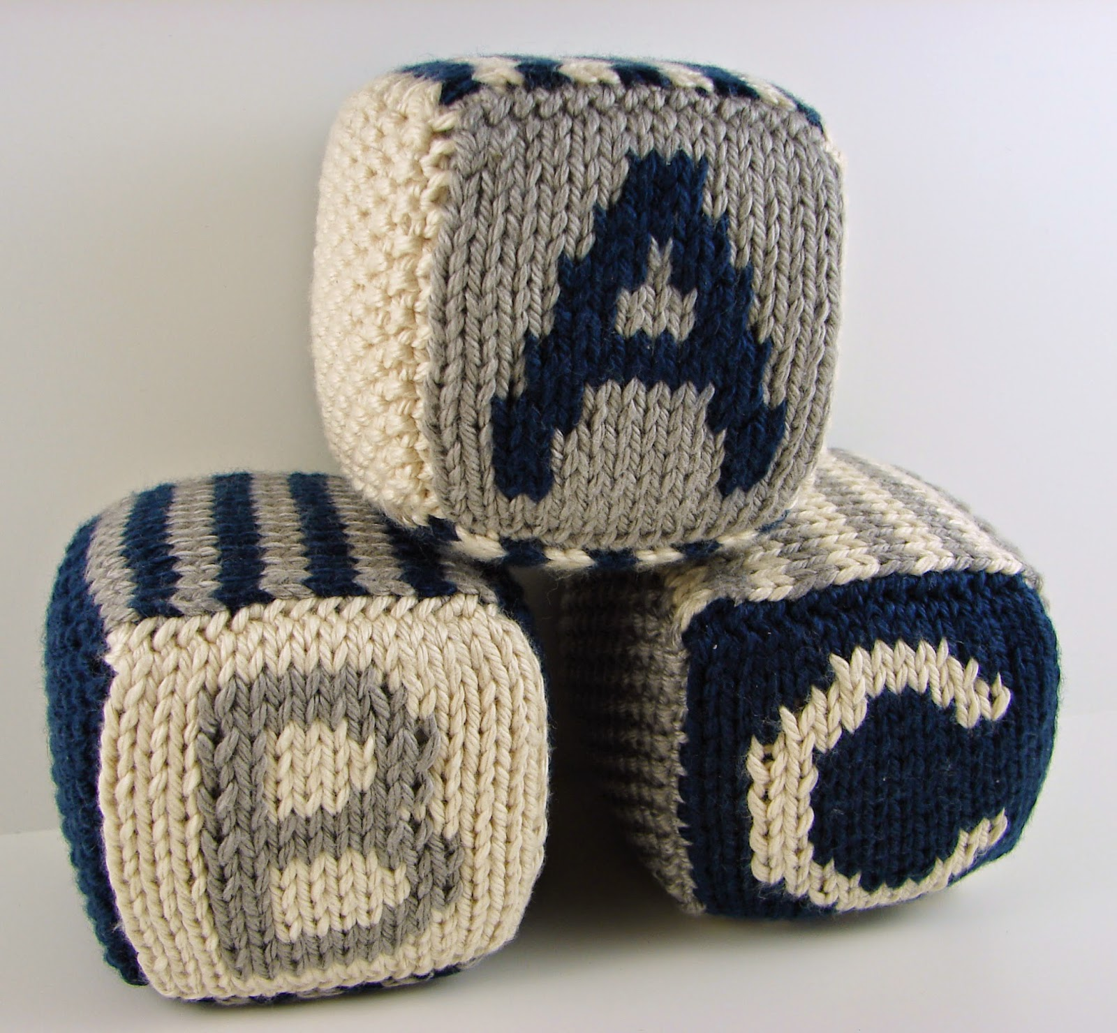 knit, blocks, foam, toys, hand knit, letter, number, striped, white, navy blue, gray