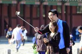 tourist attraction photograph with selfie stick health and safety fail