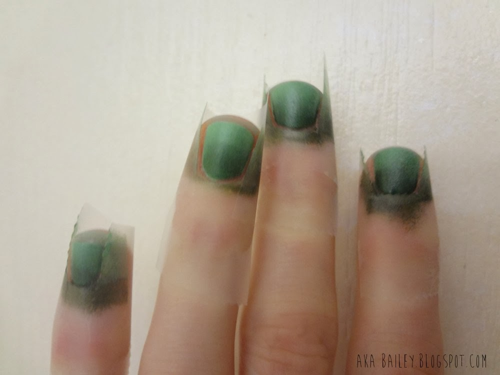 Taped nails with sponged on ombre