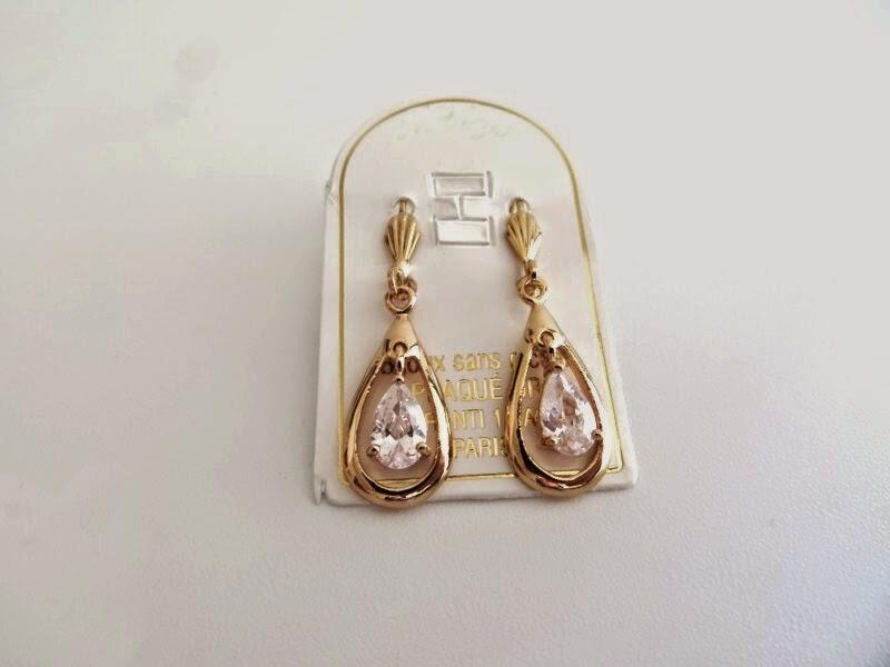 http://www.balkal.fr/promos-de-noel/boucle-oreille-pendante-or-detail