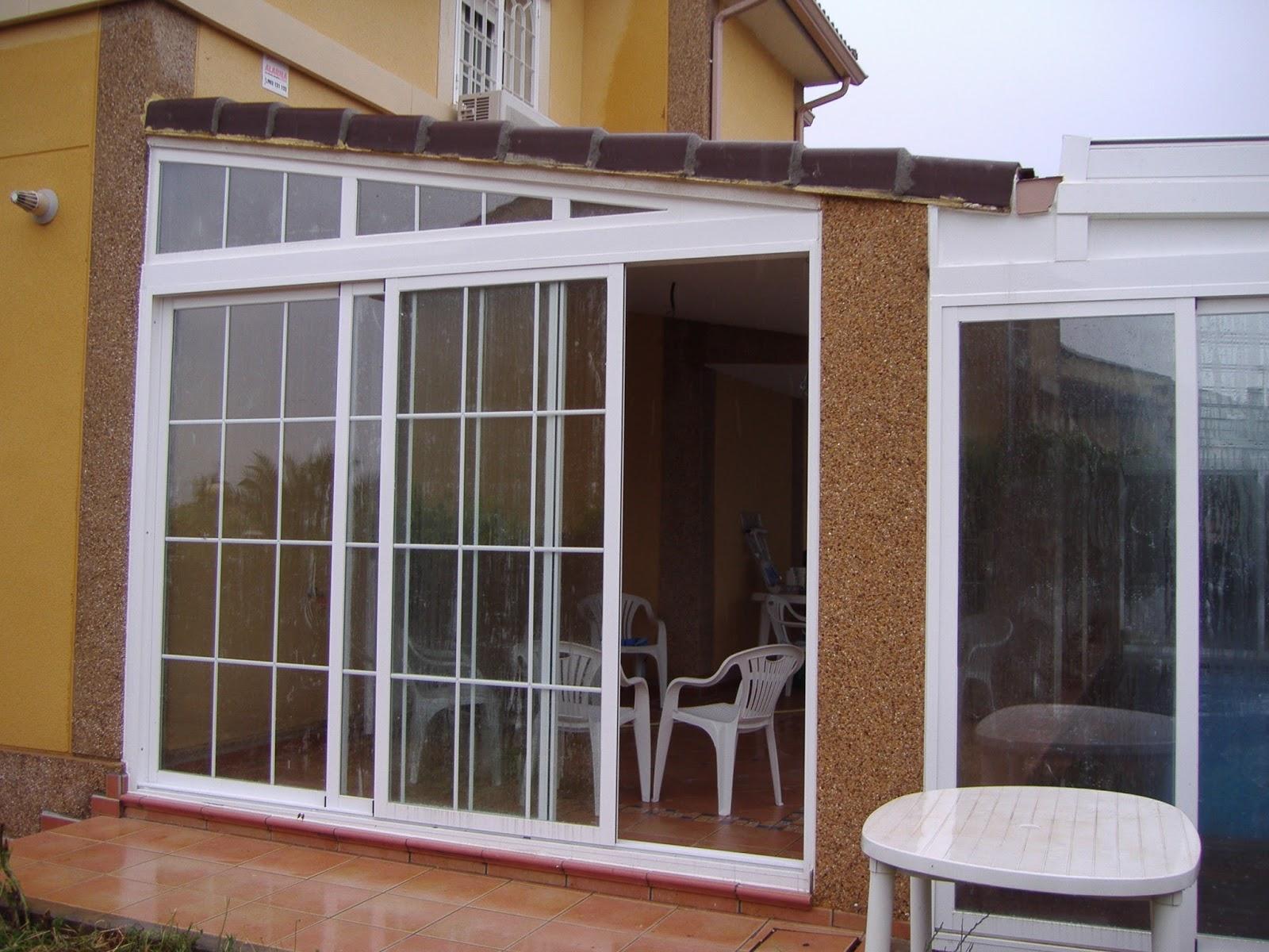 Carpinter a de aluminio cerramientos de cristal m laga - Puertas para porches ...